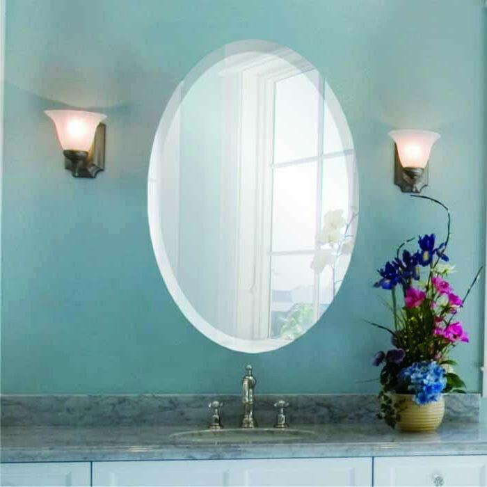 oval frameless wall mirror with beveled edge