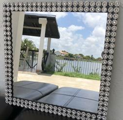 Silver Decor And Black Frame Mirror